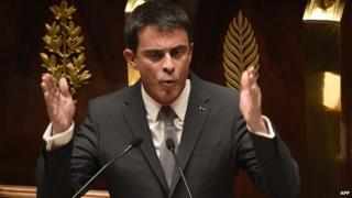 French Prime Minister Manuel Valls speaks prior to parliamentary vote of confidence over the government's economic reform at the French National Assembly on February 19, 2015 in Paris