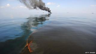 Oil burns during a controlled fire May 6, 2010 in the Gulf of Mexico following a massive oil leak from the sinking of the Deepwater Horizon oil platform off the coast of Louisiana.