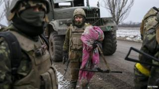 Ukrainian servicemen who fought in Debaltseve are seen near Artemivsk