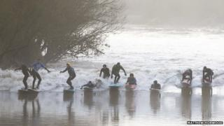 Surfers on the Severn Bore