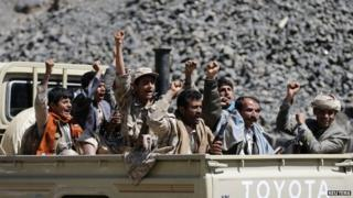 Houthi rebels ride a truck in Sanaa on 15 February 15