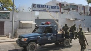 Somali security officers are seen in front of the Central Hotel in Mogadishu, Somalia, 20 February 2015
