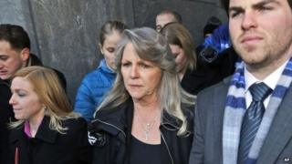 Former first lady Maureen McDonnell, centre, leaves federal court with her son Bobby, right, and daughter Cailin Young, left, after being sentenced to one year and one day on corruption charges in Richmond, Virginia