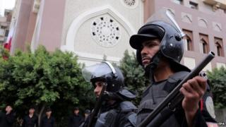 Egyptian policemen guard the Qatari embassy during a demonstration in Cairo, Egypt, 21 February 2015