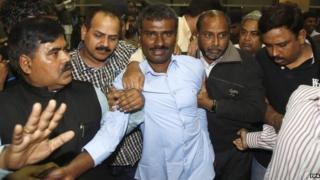 Indian Jesuit priest, Father Alexis Prem Kumar (C), arrives after his release from captivity by unidentified gunmen in Afghanistan, at the Indira Gandhi International airport, New Delhi, India, 22 February 2015. A