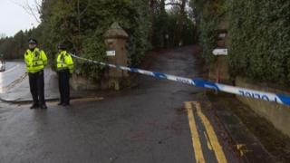 Police in Glasgow stand at cordon nearby where 24-year-old woman was raped on Maryhill road