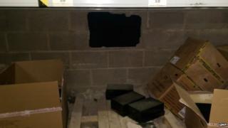 Hole in Heywood warehouse wall