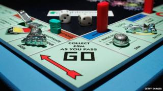 "Monopoly board, focused on ""Go"" square"