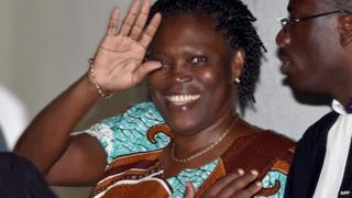 """Ivory Coast""""s former first lady Simone Gbagbo waves as she arrives at the Court of Justice in Abidjan, on February 23, 2015"""