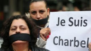 "Supporters of Charbel Khalil carry banners saying ""Je Suis Charbel"" outside the judicial palace in Beirut, Lebanon (23 February 2015)"