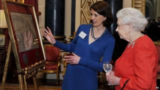 The Queen is shown a copy of the Magna Carta at Buckingham Palace by Dr Claire Breay
