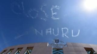 "A sky-writing reads ""Close Nauru"" above Parliament House in Canberra, Australia, 17 February 2015."