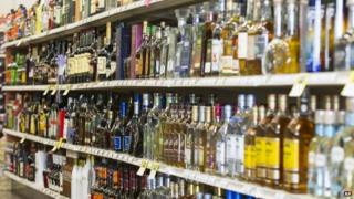 Shelves are filled with bottles of liquor at on Thursday, 19 February 2015