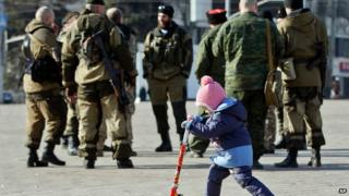 Russia's Vladimir Putin says war with Ukraine 'unlikely'