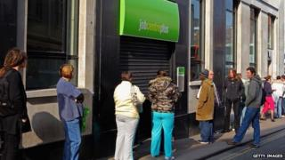 People queue outside a Job Centre in Bristol