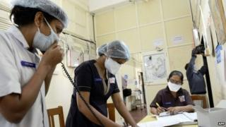 Indian medical staff work at the swine flu (H1N1) isolation ward of the Ahmedabad Civil Hospital in Ahmedabad on February 3, 2015
