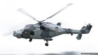 Royal Navy Wildcat Attack helicopter in flight in Somerset in 2013