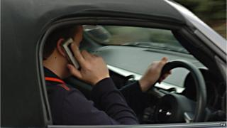 Driver using mobile phone (picture posed by model)