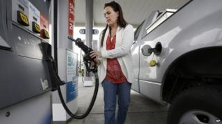 Lady filling up her truck with petrol