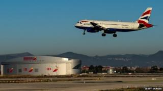 A plane operated by British Airways lands at Aena operated Barcelona