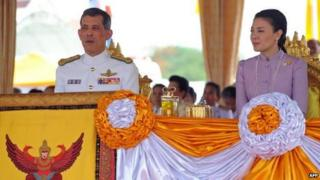 Prince Maha Vajiralongkorn (L) and his consort Princess Srirasmi (R) look on during the Royal Ploughing ceremony in Bangkok, 10 May 2007.