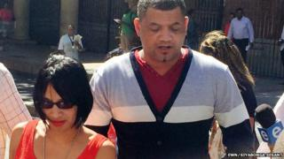 Celeste Nurse (in orange dress) and her husband Morne (in cardigan) leaving the Cape Town Magistrates Court on 27 Febraury