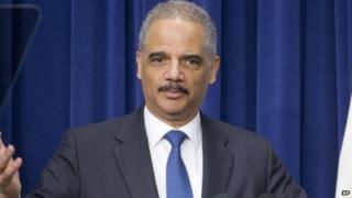 Attorney General Eric Holder speaks to law enforcement officers and guests in the Old Executive Office Building on the White House Complex in Washington 11 February 2015