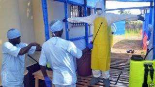 Workers at the Ebola Transit Center in Forecariah, Guinea, November 18th 2014