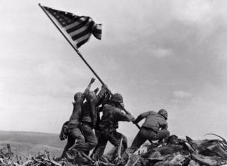 US marines raising the American flag on Iwo Jima