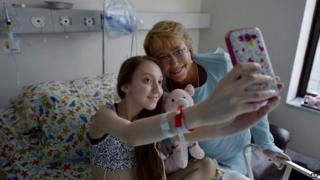 President Michelle Bachelet poses for a selfie with Valentina Maureira at a hospital in Santiago, Chile, 28 Feb 2015