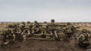 Soldiers from the 1st Battalion The Royal Welsh, scan the horizon for the enemy during Exercise Black Eagle in Poland.