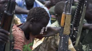 Former child soldiers at disarmament ceremony, South Sudan