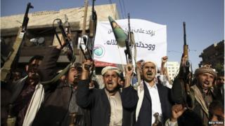 Followers of the Houthi movement shout slogans during a demonstration