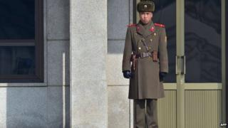 A North Korean soldier stands guard at the North side of the truce village of Panmunjom in the Demilitarized Zone dividing the two Koreas on 4 February 2015