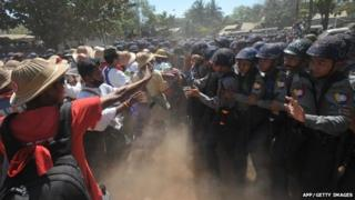 Myanmar riot police confront students in Letpadan town in Myanmar on 3 March 2015