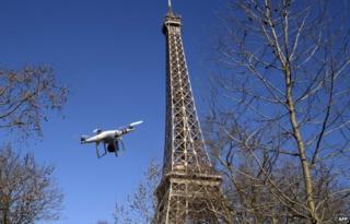 Illustration of drone beside Eiffel Tower (27 Feb)