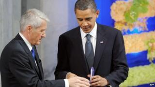 Norwegian Nobel Peace Prize Committee chairman Thorbjoern Jagland handing the diploma and medal to Nobel Peace Prize laureate, US President Barack Obama