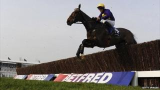 Davy Russell riding Lord Windermere clear an early fence before going on to win The Betfred Cheltenham Gold Cup Steeple Chase