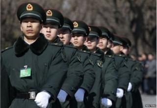 Soldiers from China's People's Liberation Army (PLA) march ahead of the opening session of Chinese People's Political Consultative Conference (CPPCC) at Tiananmen Square in Beijing, 3 March 2015