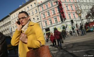 Woman talks on mobile phone in Budapest (file pic)