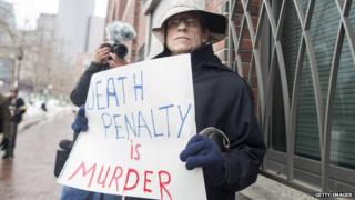 Joe Kebartas of South Boston protests the death penalty outside of the entrance to the John Joseph Moakley United States Courthouse