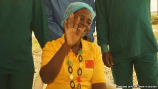 Beatrice Yardolo smiles and waves after recovering from Ebola