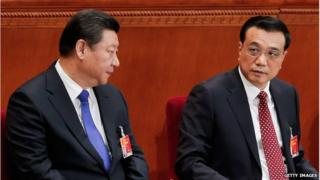 Chinese President Xi Jinping (L) with Chinese Premier Li Keqiang at the opening of the 3rd Session of the 12th National People's Congress at the Great Hall of the People on 5 March 2015 in Beijing, China