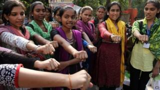 Indian girls take a pledge to act towards stopping atrocity on women on the second anniversary of the deadly gang rape of a student on a bus in Delhi, in Ahmadabad, December 16, 2014