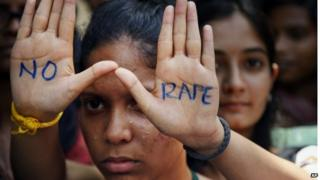 "An Indian student displays ""NO RAPE"" message painted on her hands during a demonstration to demand death sentence for four men convicted of rape and murder of a student on a moving bus in New Delhi bus last year, in Hyderabad, India."