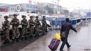 Police control the site after a knife attack outside the Guangzhou Railway Station, Guangdong province, 6 March 2015.