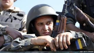 Ukrainian serviceman in helmet