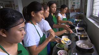 Trainee maids learning to cook