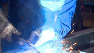 Man working with metal