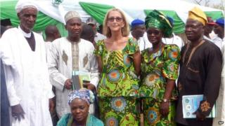 Seattle missionary Phyllis Sortor stands at centre with a delegation of area dignitaries in a town in Nigeria.